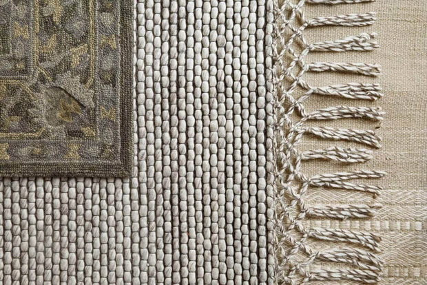 Calacatta Ivory Rug lifestyle shot with fringe and texture details.