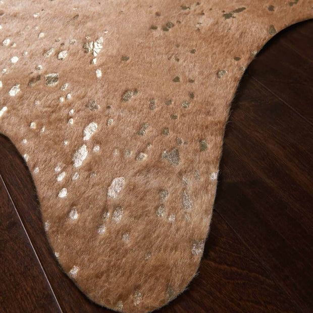 Mohave Tan / Gold Rug Cowhide Rug. Neutral cowhide rug with metallic details.