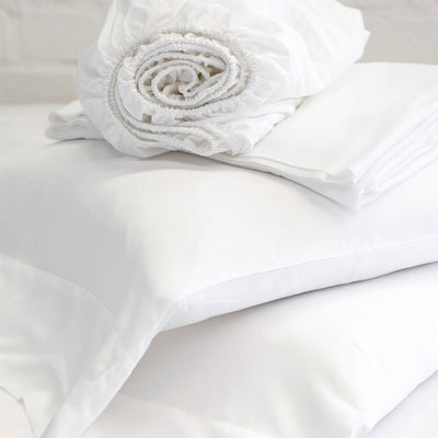 The Taman Bamboo Sheet Set in white is a fitted sheet, flat sheet, and pillowcases made from bamboo.