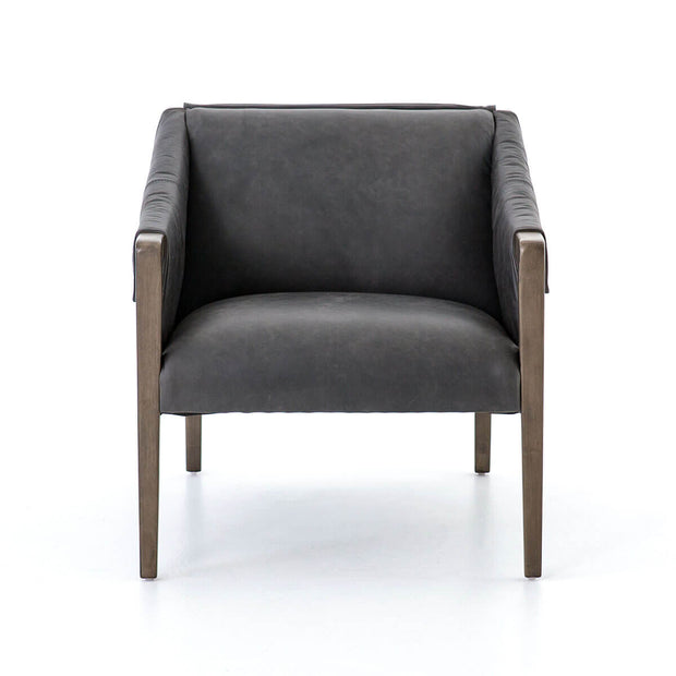 Rustic black leather armchair with parawood legs and arms.