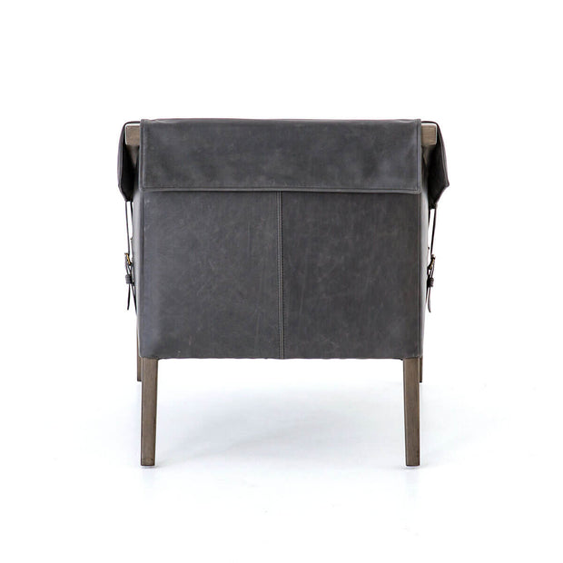 Back view of the Canmore Chair with black leather seat and parawood legs.