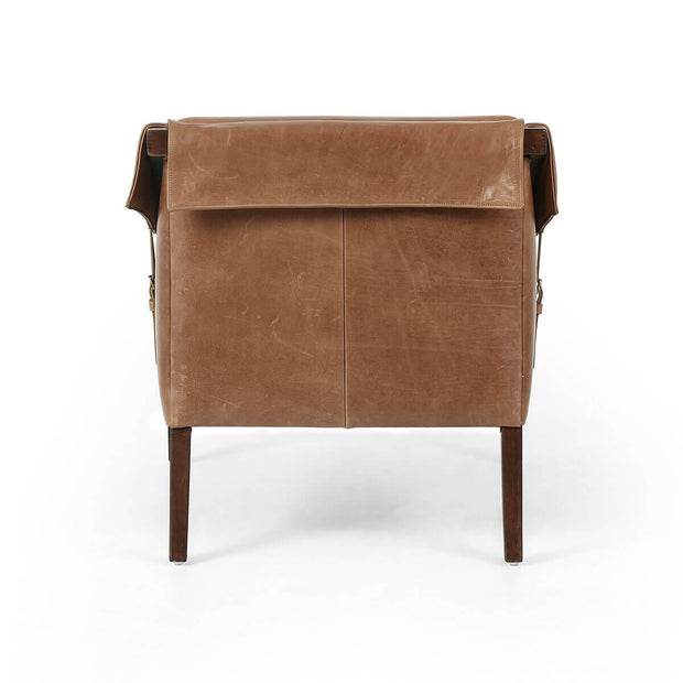 Back view of the rustic leather arm chair with a birch frame.