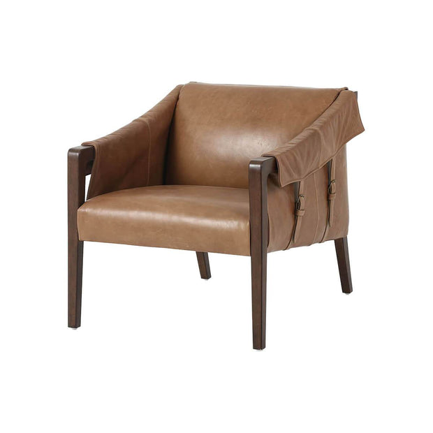 The Canmore Chair has a warm taupe dakota top-grain leather seat, grey birch frame, and buckle details.