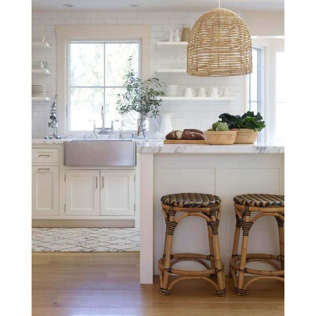 Beehive shaped chandelier in a beach inspired kitchen.