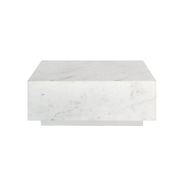 The Milan Coffee Table is a slab of white marble with a simple, square shape.