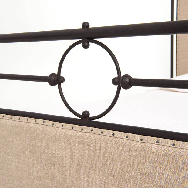 Closeup of the aged iron tube frame and decorative borders on the San Mateo Bed