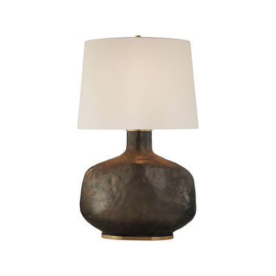 Beton Table Lamp Lamp has a crystal bronze sculptural base with a neutral linen shade.