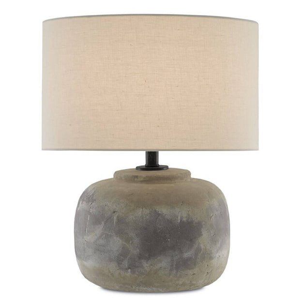 The Goderich Table Lamp has a concrete base with a patina antique finish and beige linen shade.