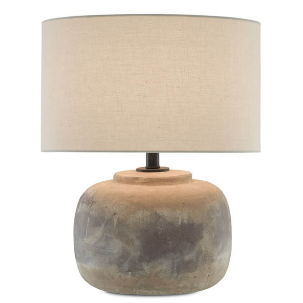 Earthy looking round table lamp with a concrete base in a antique patina finish.