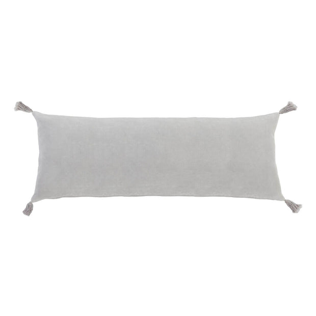 The Banjul Pillow - Light Grey is a light grey velvet rectangular pillow with tassels in the corner.