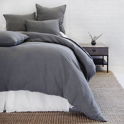 The Berlin Bedding Collection in the colour midnight is a 100% linen duvet with frayed edges and tie closures.