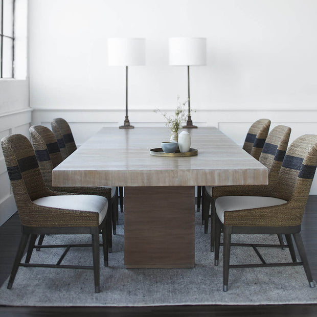 Large, rectangle hardwood dining table in a formal dining room.