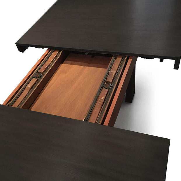 Large, rectangle wood dining table with removable leaves.