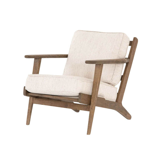 The Puebla Lounge Chair is a comfortable chair with thick, avant natural coloured cushions with a naturally weathered finish on the wood frame.