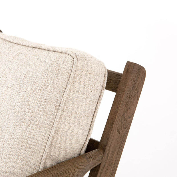 Closeup of the solid wood frame and thick, white back cushion.
