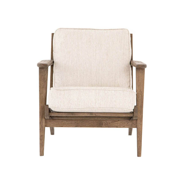 White lounge chair with a solid wood frame and a Adirondack inspired shape.