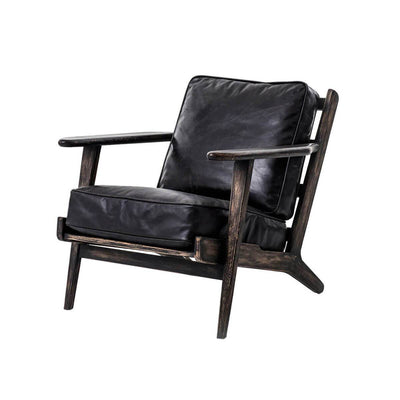 The Puebla Lounge Chair is a comfortable chair with thick, rialto ebony coloured cushions with a naturally weathered finish on the wood frame.