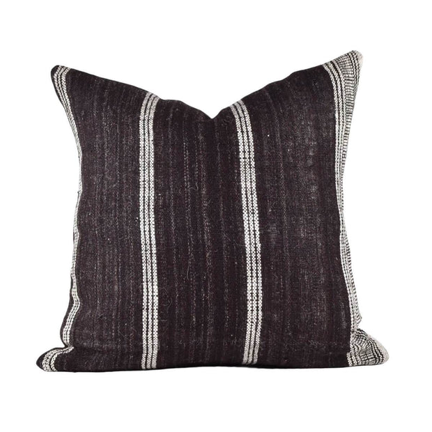 The Bhujodi Pillow - Brown is a hand-woven throw pillow with dark brown and white stripes.