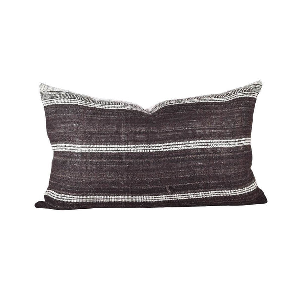 Small, hand-woven wool pillow with brown and white stripes.
