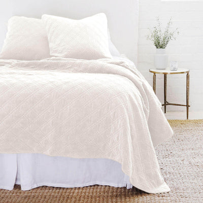 The Waterloo Bedding Collection in cream made from 100% stonewashed cotton velvet with a diamond quilted pattern.