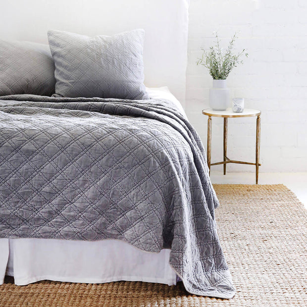 The Waterloo Bedding Collection in blue made from 100% stonewashed cotton velvet with a diamond quilted pattern.