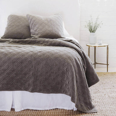 The Waterloo Bedding Collection in pewter made from 100% stonewashed cotton velvet with a diamond quilted pattern.