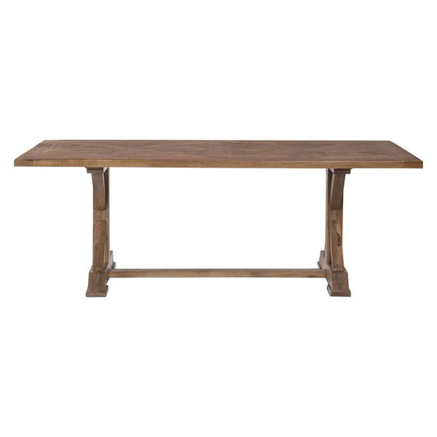 The St. Jacobs Dining Table is made of solid mango wood in a brindled ash finish and has an x shaped trestle base and inlaid tabletop.