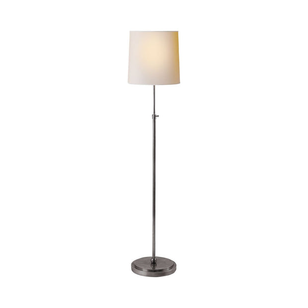 Traditional simple floor lamp in antique silver with a paper shade.