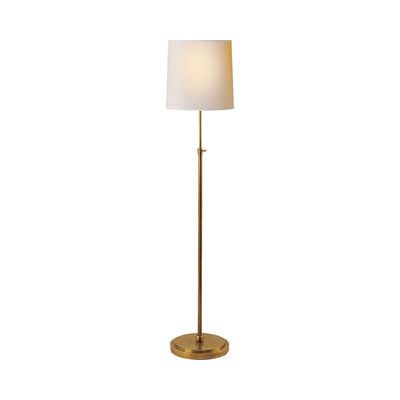 Traditional simple floor lamp in hand rubbed brass with a paper shade.