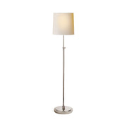 Traditional simple floor lamp in polished nickel with a paper shade.