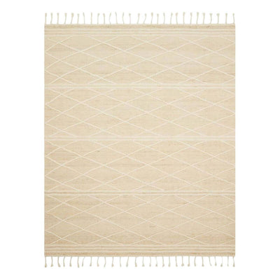 The Antibes Ivory / White Rug is a natural rug handwoven in India with neutral colours, subtle pattern and braided details.