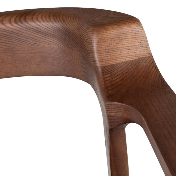 Solid walnut wood grain and rounded back details on the Odense Dining Chair.