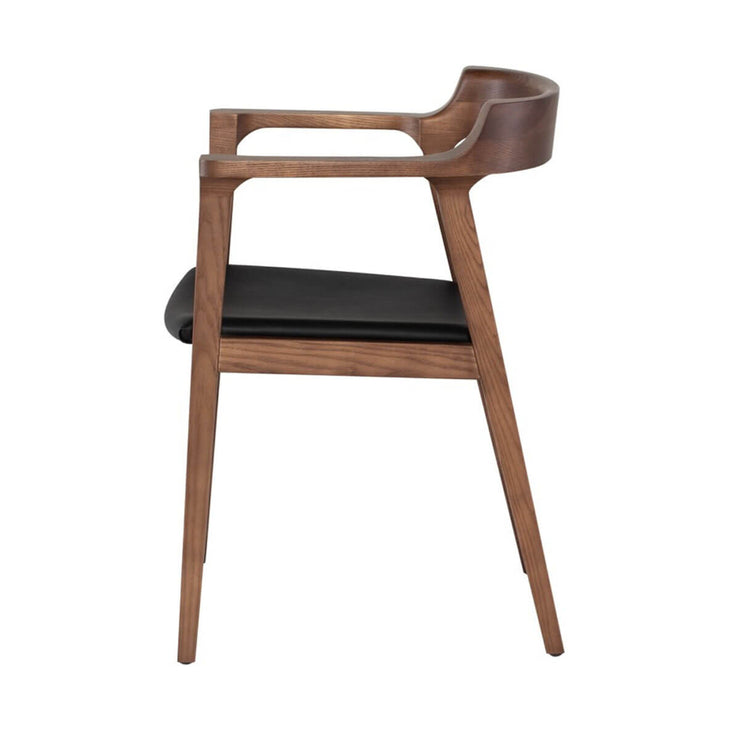 Side view of the midcentury modern dining chair with rounded back, black leather seat and solid walnut wood frame.