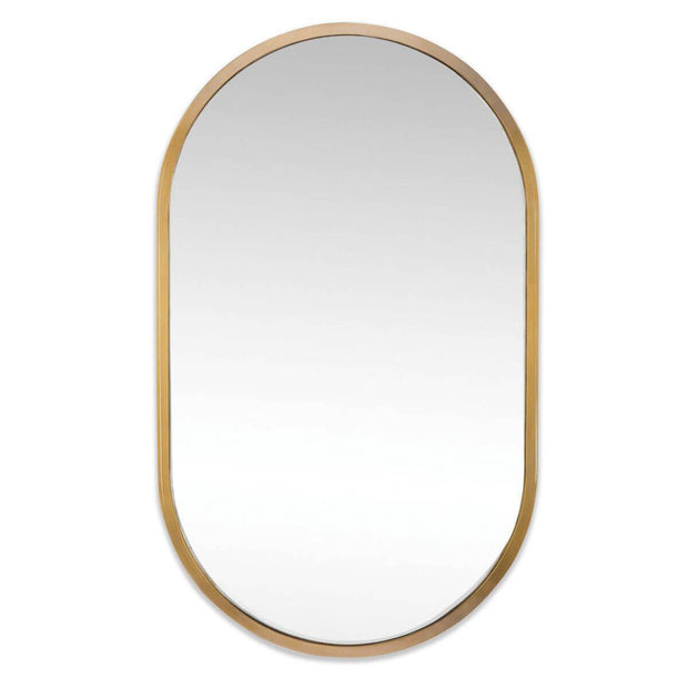 The Almere Mirror has a natural brass arched frame and an elongated oval mirror.