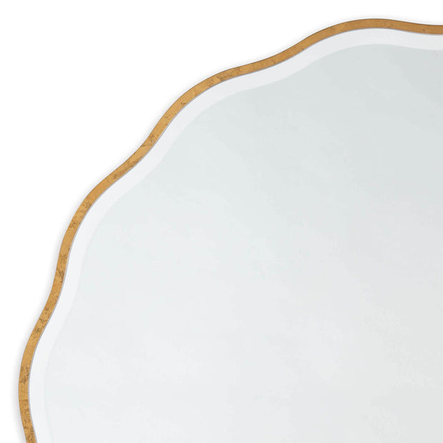 Feminine, glamorous mirror with wavy edges and a gold leaf finish.