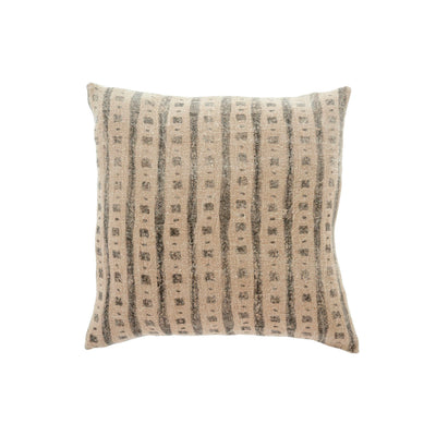 Patterned linen pillow with neutral palette.