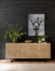 Mid century modern sideboard in an entry way.