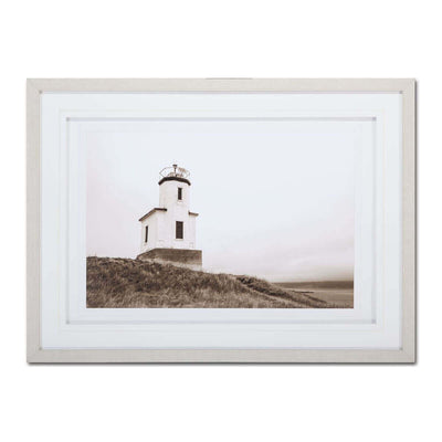The Cattle Point Lighthouse is a sepia lighthouse print framed behind glass.