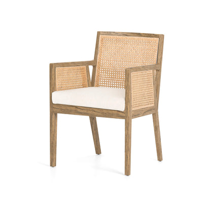 Dining chair made up of linen, nettle wood, and cane.