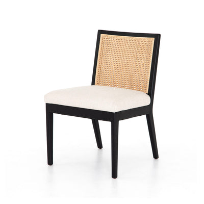 Black wooden dining chair with upholstered seat and cane backing.