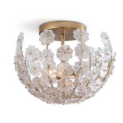 The Veneta Semi Flush Mount has a natural brass frame and canopy with cast glass flower bowl shaped shade.
