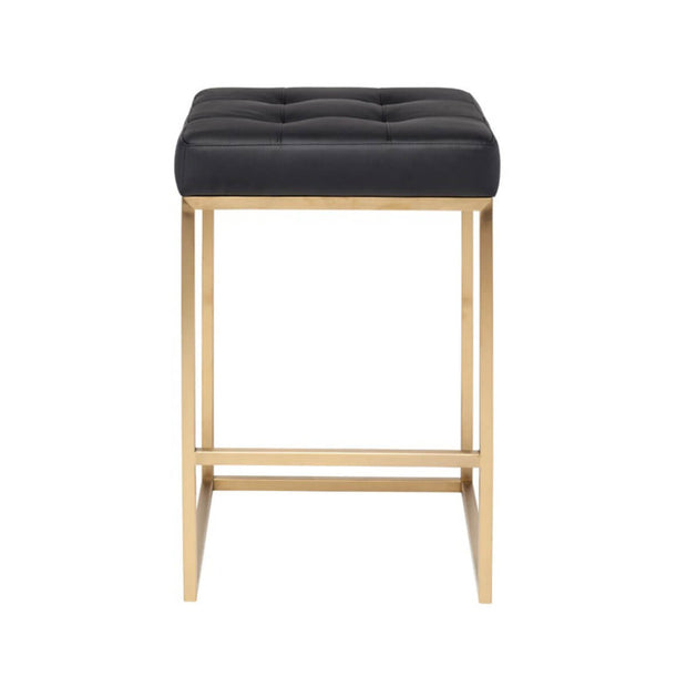 Modern counter stool with a black leather, tufted seat and minimal gold frame.