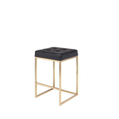 Glam counter stool with a brushed gold stainless steel frame and black leather seat.