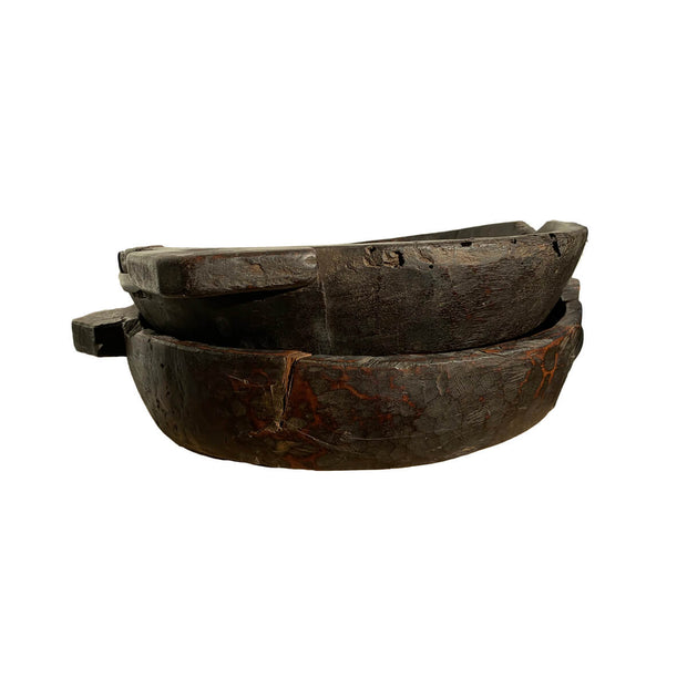The Vintage Chipati Bowls is a rustic wooden decorative bowl.