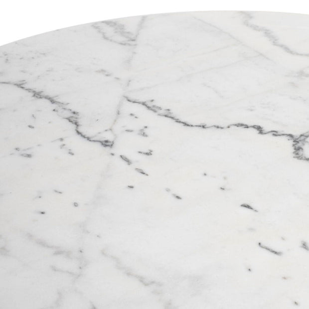 White marble details on the round, pedestal dining table.