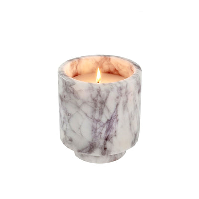The Clermont Marble Candle in White features a votive made of white marble with black veining.