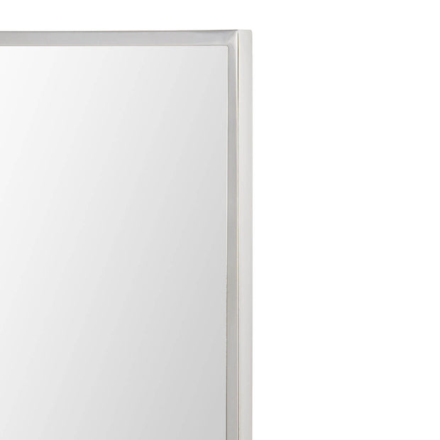 Polished stainless steel frame on a large bathroom mirror.
