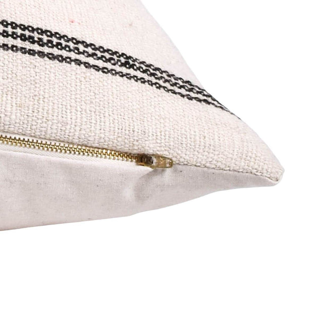 Cream, woven wool pillow with charcoal stripes, zipper closure, and white backing.