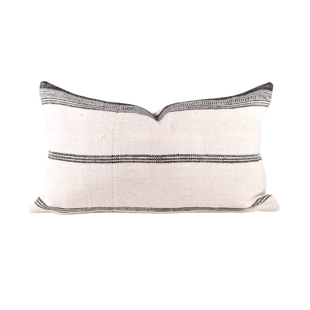 Rectangular bhujodi pillow with vertical charcoal stripes.
