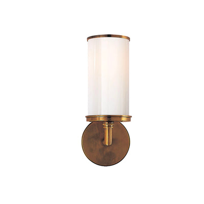 Hand-rubbed antique brass is a simple sconce with white glass. Meant to compliment a bathroom vanity.